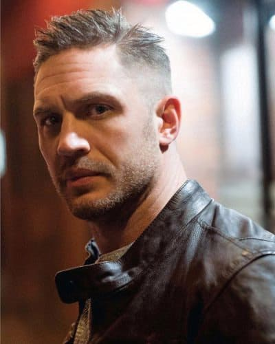 Tom Hardy's spiky, bald fade haircut with shaved beard.