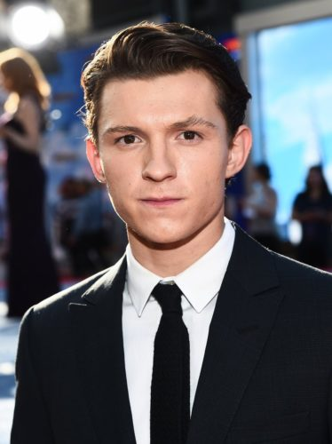 Tom Holland with a clean cut hairstyle.