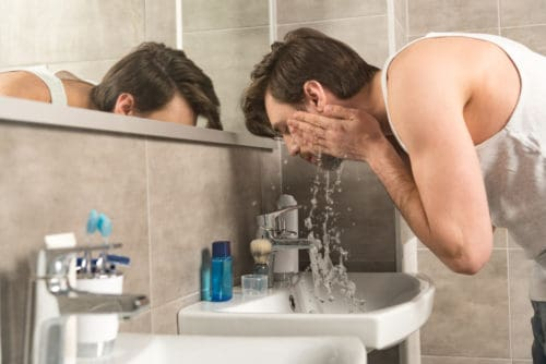 Exfoliating with a quality beard wash.
