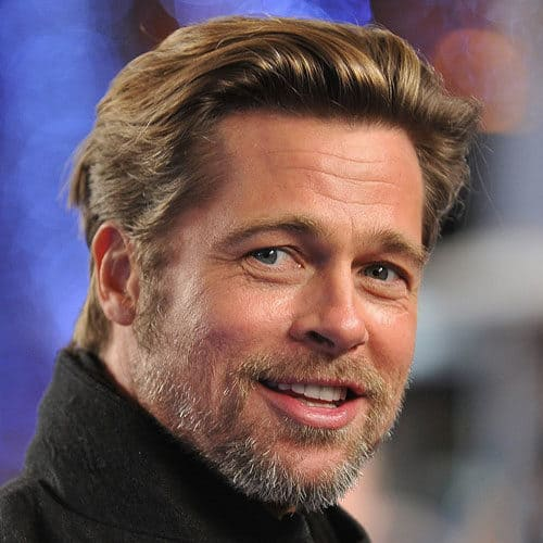 Brad Pitt patchy scruff facial with thick sideburns