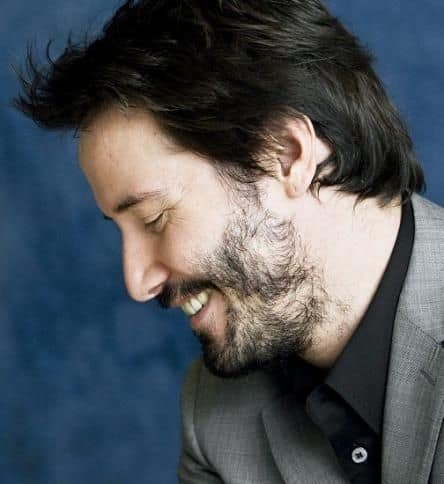 Does Keanu Reeves have alopecia barbae? His patchy beard is as famous as he is.