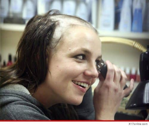 Britney Spears shaving with balding clippers.