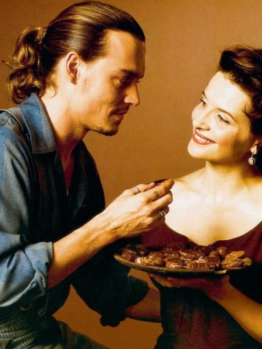 Johnny Depp's long hair is pulled back in a ponytail for the movie Chocolat.