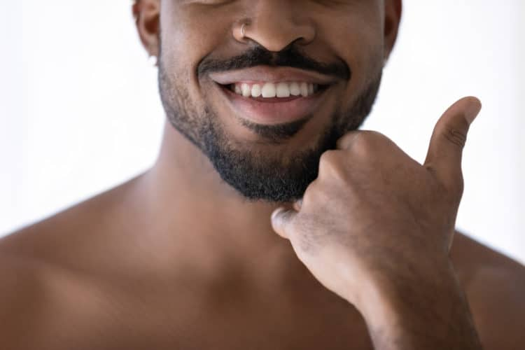 Learn how to use beard balm and tame unruly facial hair.