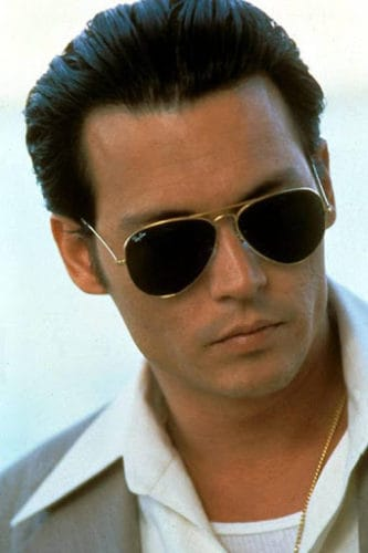 Johnny Depp as Donnie Brasco. Sporting slicked back hair with Ray-Ban sunglasses.
