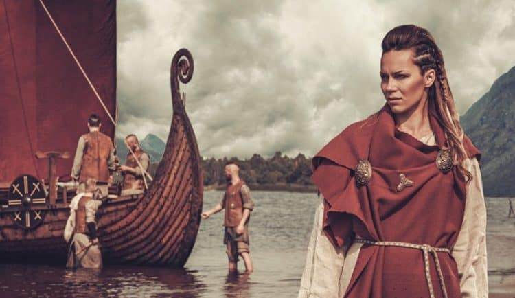 Female Viking hairstyle with pulled back hair and side braids.
