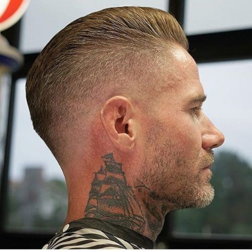 The clean fade crew cut can be paired with a stubble beard