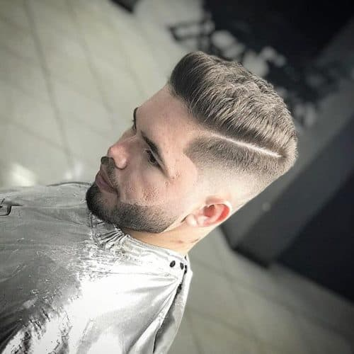 Cool and trendy beard fade with parted hairstyle.