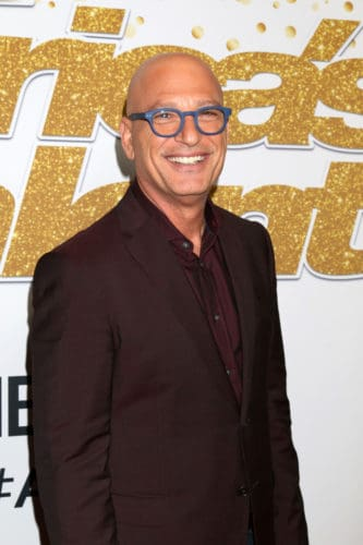 AGT Judge Howie Mandel with a shaved bald head.