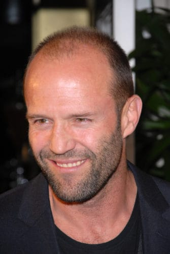 Jason Statham stubble beard and bald style