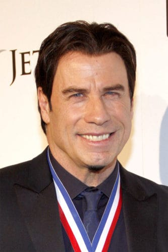John Travolta chin puff goatee and full head of hair.