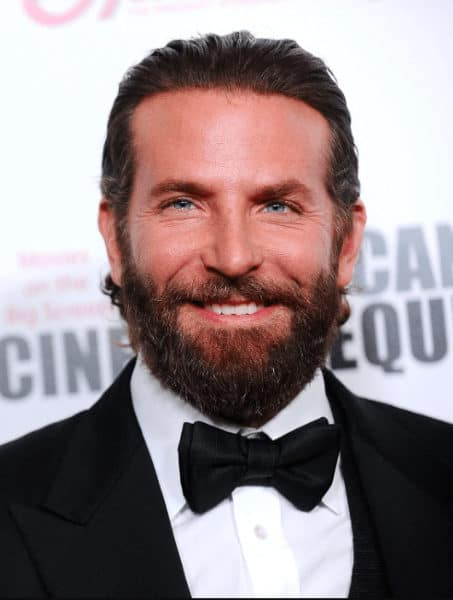 Bradley Cooper with slicked back hair and long beard