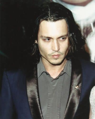 Johnny Depp long hair with a central part.
