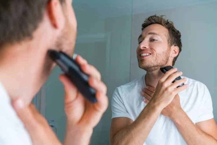 Facial hair removal with electric razor.