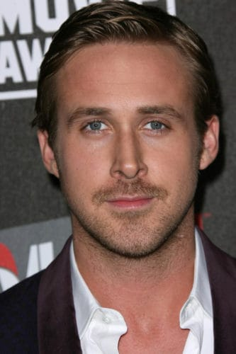 Ryan Gosling thin mustache with patches.