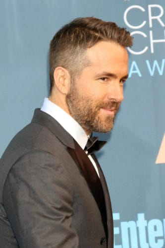 Ryan Reynolds side part crew cut with taper.