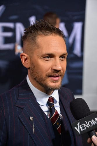 Tom Hardy longer spiked hair at the VENOM premiere.