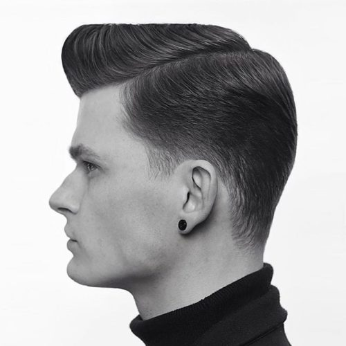 Taper fade haircut with a side part
